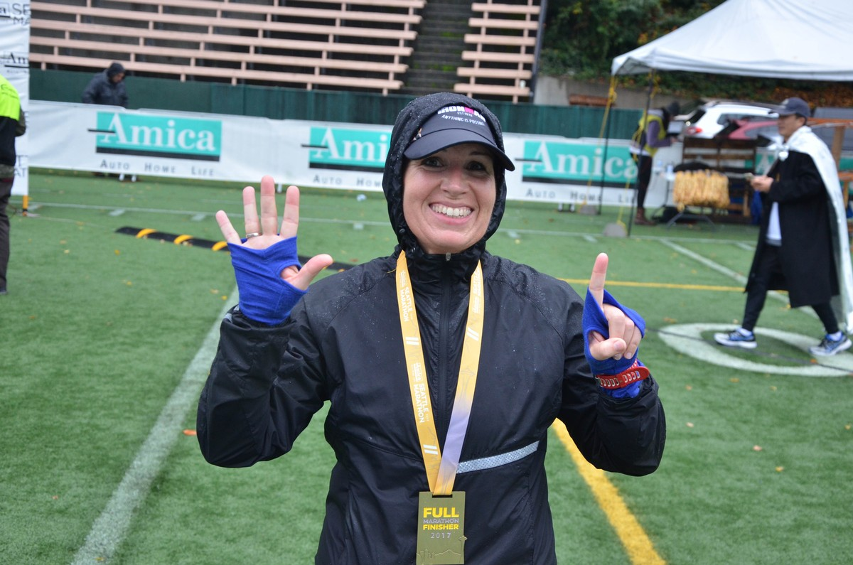 At the soggy finish line of marathon #6. 